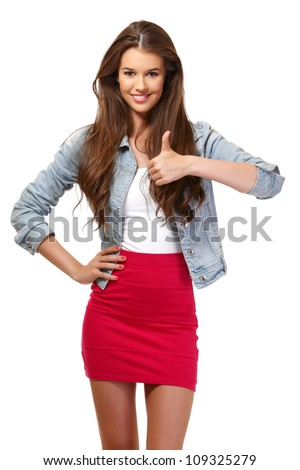 nice young woman smiling in studio - stock photo