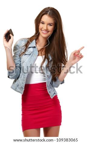 nice young woman speaking on earphone in studio - stock photo