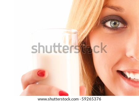 Nice young woman stretches glass with milk, it is isolated on white background. - stock photo