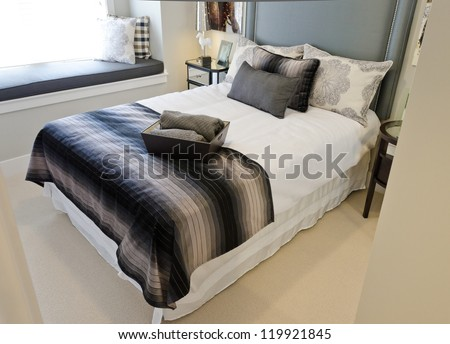 Nicely decorated contemporary bedroom at the day time. Interior design. - stock photo