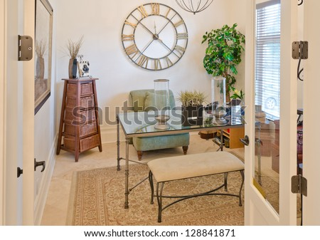 Nicely decorated den, home office in a luxury home. - stock photo