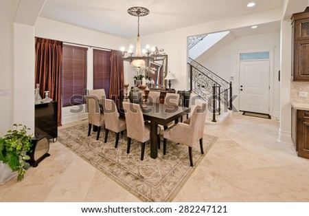 Nicely decorated dining, lunch room. Dining table and a few chairs around. Interior design.
