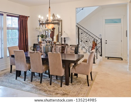 Nicely decorated living ( lunch ) room. Dining table and some chairs. - stock photo