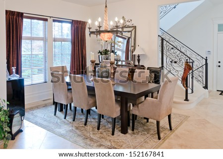 Nicely decorated luxury living ( lunch ), dining room. Dining table and some chairs. Interior design. - stock photo