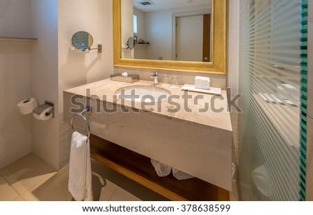 Nicely decorated modern washroom, bathroom in the luxury hotel. Interior design. - stock photo