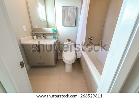 Nicely decorated modern washroom, bathroom with the toilet sit, sink and bath tab. Interior design. - stock photo