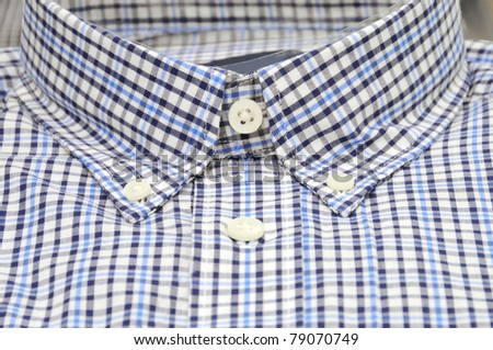 Nicely folded men shirt with focus on the collar