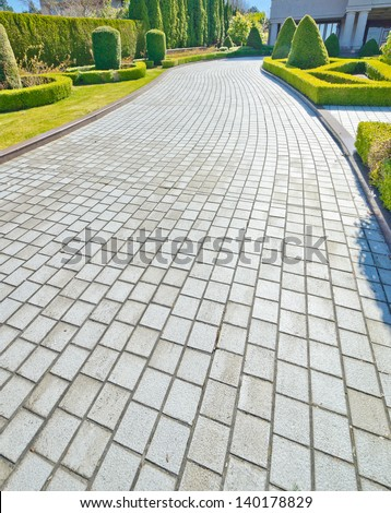 Nicely paved long driveway, trail, sidewalk, path. North America. - stock photo