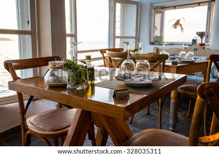 nicely set dinner table at a seaside restaurant - stock photo