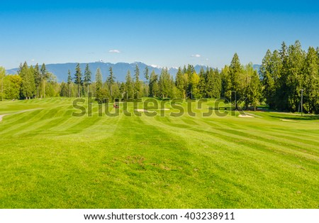 Nicely trimmed beautiful golf course.