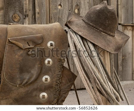 Nicely worn and distressed leather Western cowboy wear. - stock photo