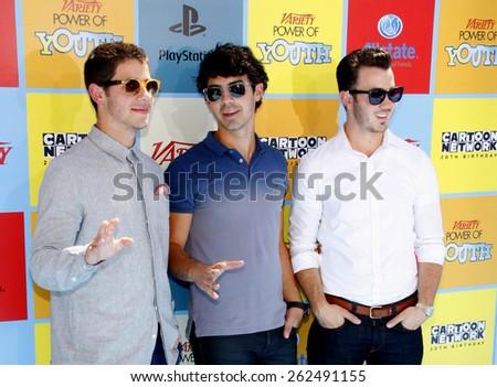 Nick Jonas, Joe Jonas and Kevin Jonas at the Variety's 6th Annual Power Of Youth held at the Paramount Studios in Hollywood on September 15, 2012. - stock photo