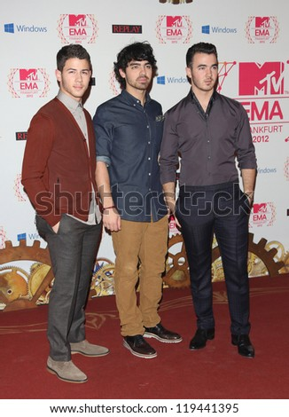 Nick Jonas, Joe Jonas and Kevin Jonas of The Jonas Brothers arriving for the The MTV EMA's 2012 held at Festhalle, Frankfurt, Germany. 11/11/2012 Picture by: Henry Harris - stock photo