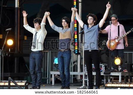 Nick Jonas, Joe Jonas, Kevin Jonas on stage for The Jonas Brothers in Concert on ABC's Good Morning America, Bryant Park, New York, NY, August 08, 2008