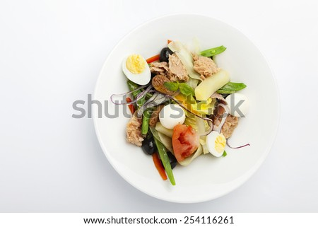 nicoise salad recipe on a white background. - stock photo