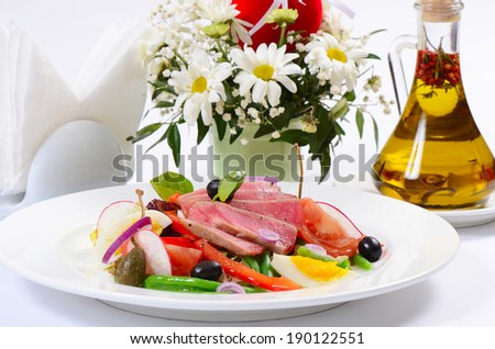 Nicoise with fresh tuna and vegetables - stock photo