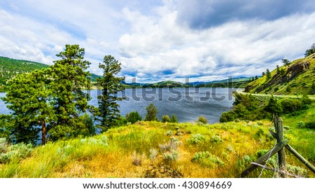 Nicola Lake in the Nicola Valley between Kamloops and Merritt in British Columbia along Highway 5A. - stock photo