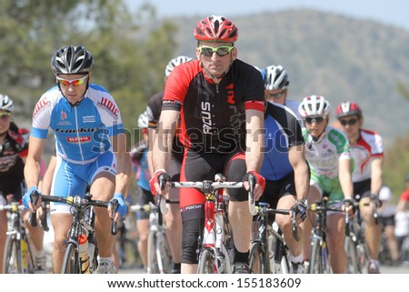 NICOSIA, CYPRUS - MARCH  23: Cyclists compete in the 2012 Annual cycling tour of Cyprus in Nicosia on March 23,2012  - stock photo