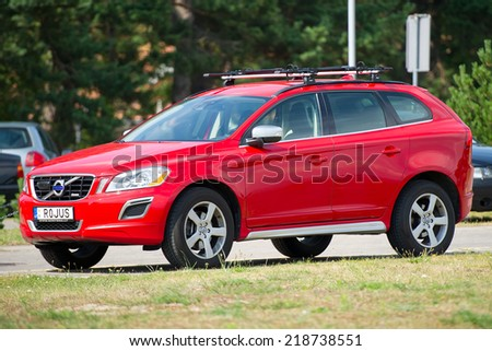 NIDA - JULY 14: Volvo XC60 Crossover on July 14, 2014 in Nida, Lithuania.The Volvo XC60 is a compact executive/entry-level luxury crossover produced by Volvo Cars and is based on Volvo Y20 platform. - stock photo