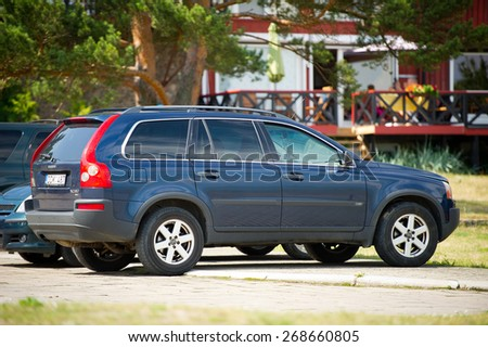 NIDA - JULY 14: Volvo XC90 Crossover on July 14, 2014 in Nida, Lithuania. The Volvo XC90 is a mid-size luxury crossover SUV produced by Volvo Cars since it was unveiled at the Detroit Motor Show 2002. - stock photo