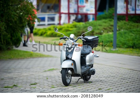 NIDA, LITHUANIA - JULY 14: YAMAHA Vino scooter (motoroler) on July 14, 2014 in Nida, Lithuania. The Vino is a scooter introduced by Yamaha Motor Company in 2004.