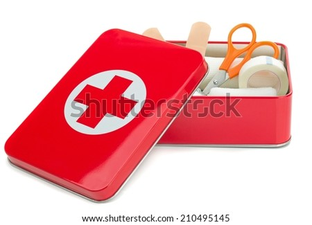 NIEDERSACHSEN, GERMANY AUGUST 10, 2014 - An open metal first aid box with contents on a white background - stock photo