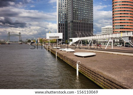 Nieuwe Maas (New Meuse) river waterfront promenade in Rotterdam downtown, Netherlands. - stock photo