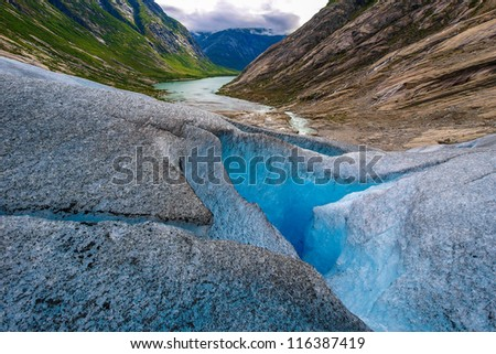Nigardsbreen is a glacier arm of the large Jostedalsbreen glacier. Nigardsbreen lies about 30 kilometres north of the village of Gaupne in the Jostedalen valley, Luster, Sogn og Fjordane county - stock photo