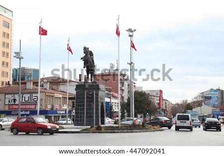 NIGDE, TURKEY - JANUARY 31: Nigde city center and Ataturk statue on January 31, 2015 in Nigde, Turkey. Nigde at Central Anatolia in Turkey. - stock photo