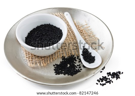 Nigella sativa seed served on a plate with white background. - stock photo