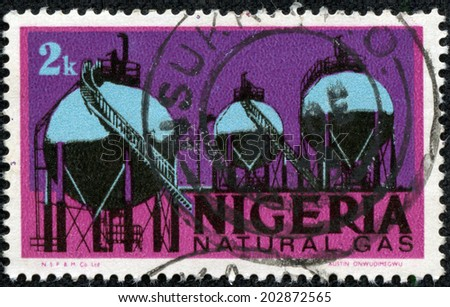 NIGERIA - CIRCA 1973: Mail stamp printed in Nigeria featuring natural gas storage tanks, circa 1973