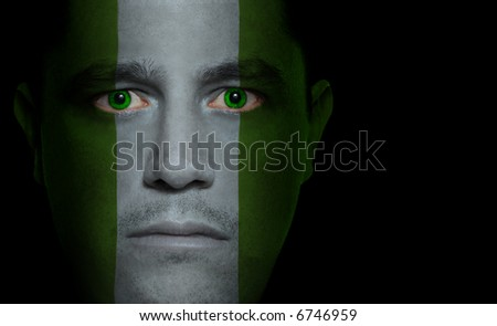Nigerian flag painted/projected onto a man's face