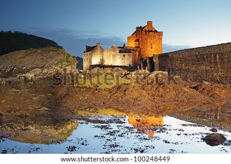 Nigh shote of Eilean Donan Castle reflecting on Loch Duich, Skye. - stock photo