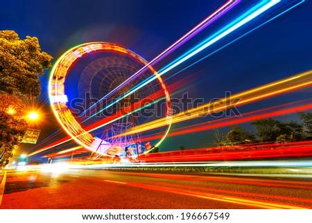 Night, a rotating Ferris wheel. - stock photo