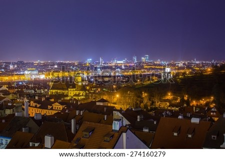 night aerial view of prague taken from the prague castle grounds. - stock photo