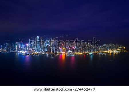 Night aerial view panorama of Hong Kong skyline and Victoria Harbor. Travel destinations - stock photo