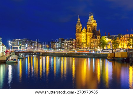 Night Amsterdam canal and Basilica Saint Nichola - stock photo