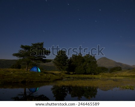 Night at lake and tent - stock photo