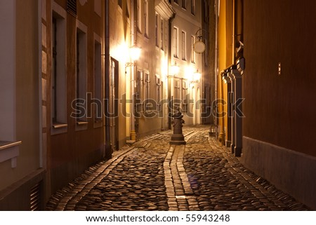 Night at narrow street in capital of Latvia - Riga - stock photo