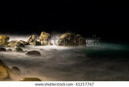 Night at the rocks beach - stock photo