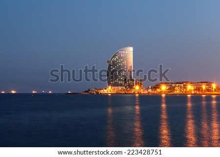 NIGHT BARCELONA - AUGUST 15: city beach, 400 meters long, it one of 10 best urban beaches of the world. Tourists rest along Barceloneta beach, August 15, 2014 in Barcelona, Spain - stock photo