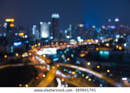Night blurred bokeh lights, city downtown background and highway interchanged - stock photo
