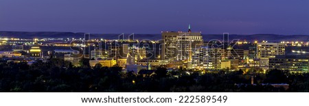 Night Boise skyline with airplane taking off - stock photo