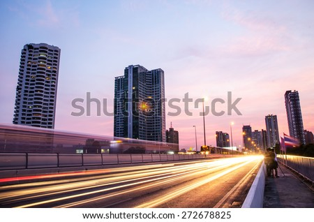 Night busy city traffic on the road with the train at Bangkok, Thailand - stock photo