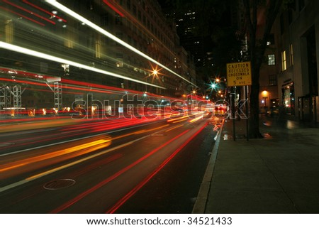Night capture of the 5th Avenue with cars driving by - stock photo