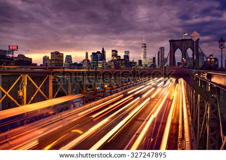 Night car traffic on Brooklyn Bridge in New York City - stock photo