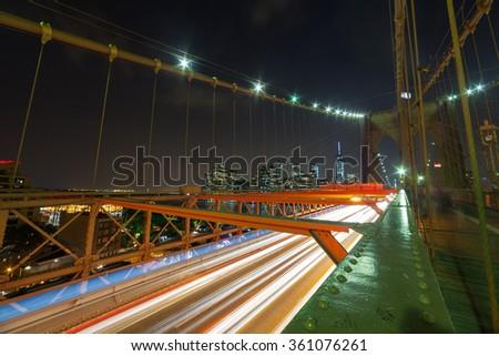 Night car traffic on Brooklyn Bridge in New York City - stock photo