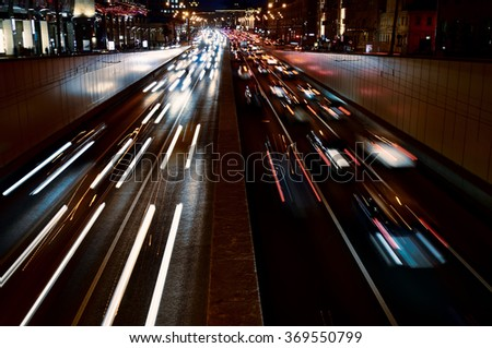Night car traffic on the Garden ring street on departure from a tunnel in the center of Moscow