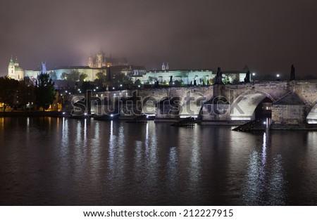 Night Charles bridge in the fog - stock photo