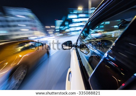Night city from the car back view,motion blur effect. - stock photo